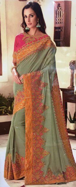 Green designer raw silk saree with pink cutwork border