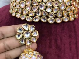Gold toned white kundan choker necklace set