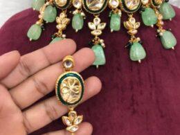 Green enameled gold toned kundan choker set
