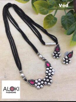 Oxidised silver toned kolhapuri black bead set