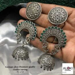 Premium quality silver look alike GS earrings with green stones