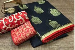 Black with gold zari woven saree with small red ruffle border