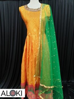 Orange patola printed synthetic silk light weight floor length gown with net dupatta