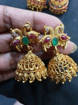 Matt finish traditional jumkha earrings with peacock studs