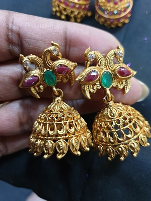 Matt finish traditional jumkha earrings with peacock studs