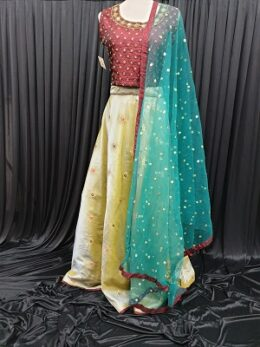 Green and brown raw silk lehenga with net dupatta