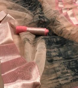 Baby pink with grey abstract prints organza silk sarees with zari border
