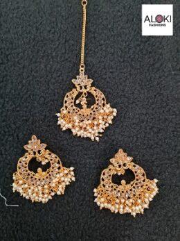 Gold toned kundan earrings and tikka jewellery set