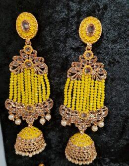 Gold toned indian kundan yellow earrings