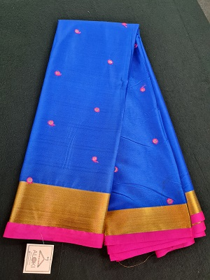bright blue coloured silk saree with all over mirror work