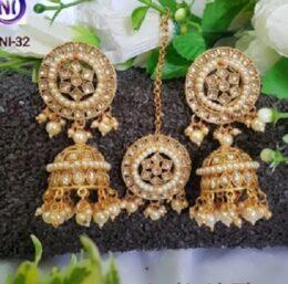Gold toned indian jumkha earrings and tikka jewellery set