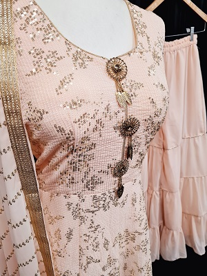 Peach colored sharara suit with all over sequin work