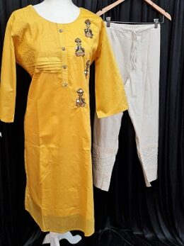 Yellow indian salwar suit with white pants