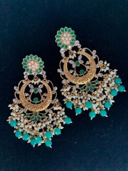 Gold toned green kundan earrings with green beads and pearls
