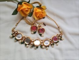 Gold tone big kundan with green and white pearls necklace set