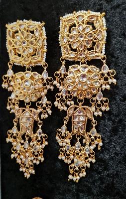 Big sized gold toned kundan earrings