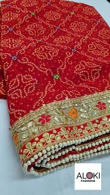 Red georgette bandhani saree with gota pati work